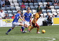 Jamie Semple controlling the ball against Andy McCarthy in the SPFL Betfred League Cup group match between Queen of the South and Motherwell at Palmerston Park, Dumfries on 13.7.19.