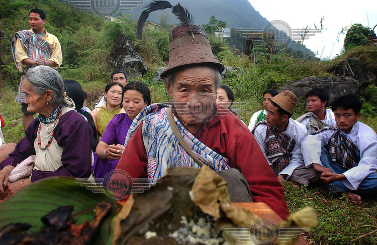 "Lepcha villagers make offerings during a ""puja"",  or prayer, to the Kanchanjunga mountain, the third highest peak in the world in Dzongu, North Sikkim."
