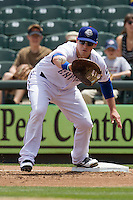 Round Rock Express first baseman Chris McGuiness #21 makes a putout against the New Orleans Zephyrs in the Pacific Coast League baseball game on April 21, 2013 at the Dell Diamond in Round Rock, Texas. Round Rock defeated New Orleans 7-1. (Andrew Woolley/Four Seam Images).