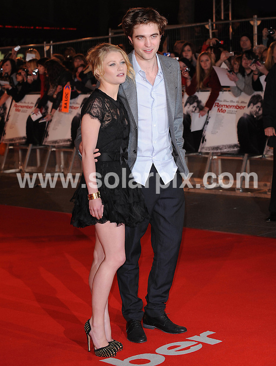 **ALL ROUND PICTURES FROM SOLARPIX.COM**.**WORLDWIDE SYNDICATION RIGHTS**.Red carpet arrivals at the UK Premiere of Remember Me.  Held at The Odeon, Leicester Square, London, ..This pic: Emilie De Ravin & Robert Pattinson..JOB REF: 10913      SSD     DATE: 17.03.2010.**MUST CREDIT SOLARPIX.COM OR DOUBLE FEE WILL BE CHARGED**.**MUST NOTIFY SOLARPIX OF ONLINE USAGE**.**CALL US ON: +34 952 811 768 or LOW RATE FROM UK 0844 617 7637**