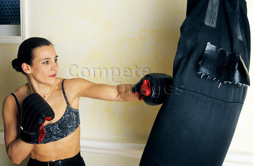 Woman working out with a punch bag