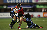 Blues pair Adan Thomas and Adam Jones close the gap on Munster wing Gerhard van den Heever.<br /> Guiness Pro12<br /> Cardiff Blues v Munster<br /> Cardiff Arms Park<br /> 01.11.14<br /> ©Steve Pope-SPORTINGWALES