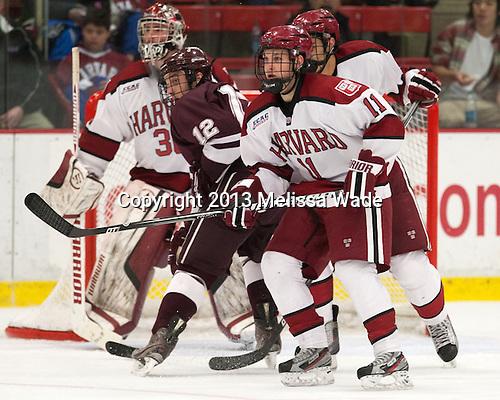 Kyle Baun (Colgate - 12), Kyle Criscuolo (Harvard - 11) - The Harvard University Crimson defeated the Colgate University Raiders 4-1 (EN) on Friday, February 15, 2013, at the Bright Hockey Center in Cambridge, Massachusetts.