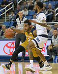 California Baptist  guard Marquise Mosley (2) drives around Nevada's Corey Henson (2) in the second half of an NCAA college basketball game in Reno, Nev., Monday, Nov. 19, 2018. (AP Photo/Tom R. Smedes)
