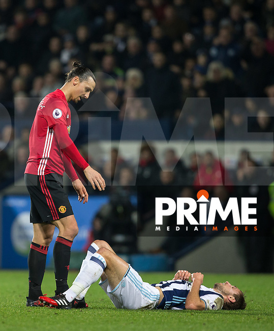 Zlatan Ibrahimovic of Manchester United stands over Craig Dawson of West Bromwich Albion after fouling him during the EPL - Premier League match between West Bromwich Albion and Manchester United at The Hawthorns, West Bromwich, England on 17 December 2016. Photo by Andy Rowland / PRiME Media Images.