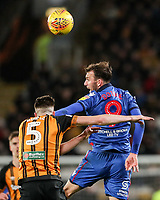Bolton Wanderers' Christian Doidge competing with Hull City's Reece Burke<br /> <br /> Photographer Andrew Kearns/CameraSport<br /> <br /> The EFL Sky Bet Championship - Hull City v Bolton Wanderers - Tuesday 1st January 2019 - KC Stadium - Hull<br /> <br /> World Copyright © 2019 CameraSport. All rights reserved. 43 Linden Ave. Countesthorpe. Leicester. England. LE8 5PG - Tel: +44 (0) 116 277 4147 - admin@camerasport.com - www.camerasport.com