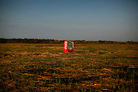 A vending machine, brought inland by a tsunami is seen in a abandoned rice field inside the exclusion zone at the coastal area near Minamisoma in Fukushima prefecture September 21, 2013. REUTERS/Damir Sagolj (JAPAN)