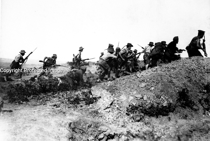 Scene just before the evacuation at Anzac.  Australian troops charging near a Turkish trench.  When they got there the Turks had flown.  Dardanelles Campaign, ca.  1915 British Official. (War Dept.)<br /> Exact Date Shot Unknown<br /> NARA FILE #:  165-BO-590<br /> WAR &amp; CONFLICT BOOK #:  636