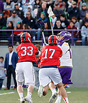 UAlbany Men's Lacrosse defeats Stony Brook on March 31 at Casey Stadium.  Tehoka Nanticoke (#1) draws two Stony Brook defenders, Matt Robison (#33), and Ryland Rees (#17).