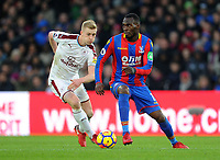 Burnley's Ben Mee vies for possession with Crystal Palace's Christian Benteke<br /> <br /> Photographer Ashley Crowden/CameraSport<br /> <br /> The Premier League - Crystal Palace v Burnley - Saturday 13th January 2018 - Selhurst Park - London<br /> <br /> World Copyright &copy; 2018 CameraSport. All rights reserved. 43 Linden Ave. Countesthorpe. Leicester. England. LE8 5PG - Tel: +44 (0) 116 277 4147 - admin@camerasport.com - www.camerasport.com
