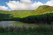 Beaver Pond in Kinsman Notch of the White Mountains, New Hampshire USA during the spring months. Jakey's Crag is in the background