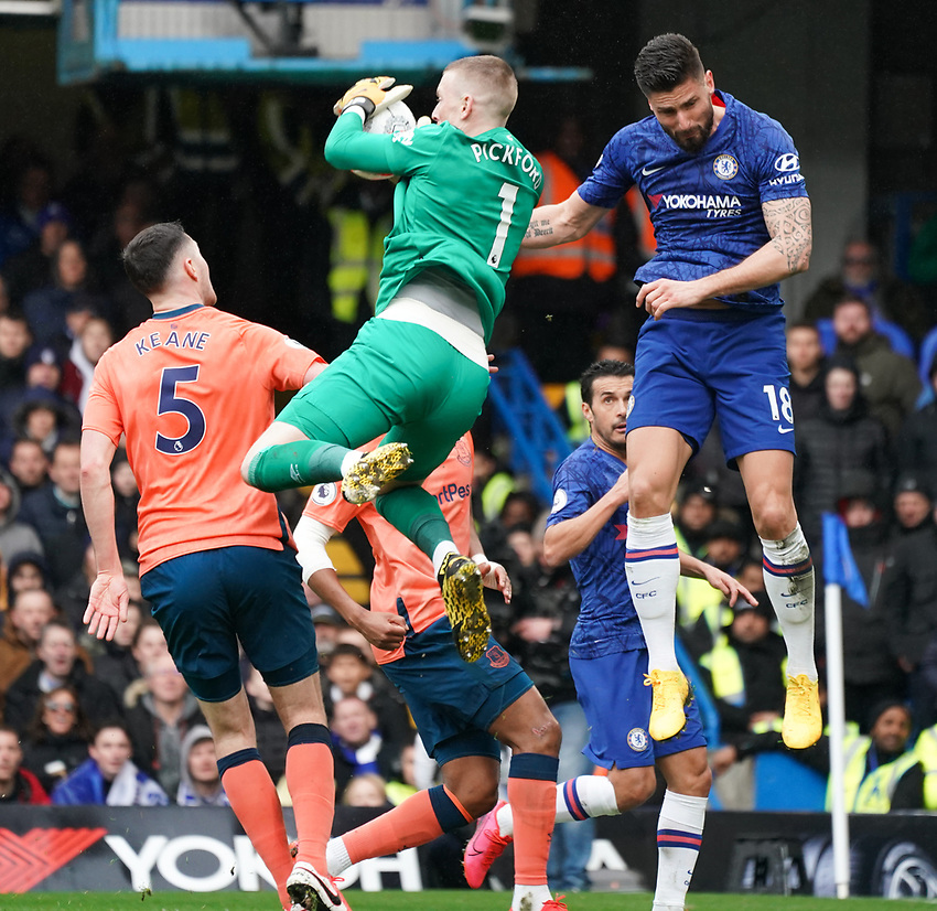 Everton's Jordan Pickford makes a save despite the attentions of Olivier Giroud<br /> <br /> Photographer Stephanie Meek/CameraSport<br /> <br /> The Premier League - Chelsea v Everton - Sunday 8th March 2020 - Stamford Bridge - London<br /> <br /> World Copyright © 2020 CameraSport. All rights reserved. 43 Linden Ave. Countesthorpe. Leicester. England. LE8 5PG - Tel: +44 (0) 116 277 4147 - admin@camerasport.com - www.camerasport.com