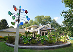 """Lowery bought this wind-driven sculpture located in her backyard from an artist at Belleville's annual Art On the Square art show and sale. """"At Home"""" with Margaret Lowery in her Lake Christine Drive home in Belleville, IL on July 24, 2019. <br /> Photo by Tim Vizer"""