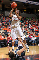 Virginia forward Sarah Imovbioh (42) shoots over Notre Dame forward Natalie Achonwa (11) during the first half of an NCAA basketball game Sunday Jan. 12, 2014 in Charlottesville, VA. Notre Dame defeated Virginia  79-72. (Photo/The Daily Progress/Andrew Shurtleff)