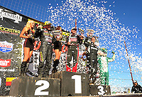 Apr 16, 2011; Surprise, AZ USA; LOORRS driver Chris Brandt (center), Brian Deegan (left) and Corey Sisler on the podium following round 3 at Speedworld Off Road Park. Mandatory Credit: Mark J. Rebilas-.
