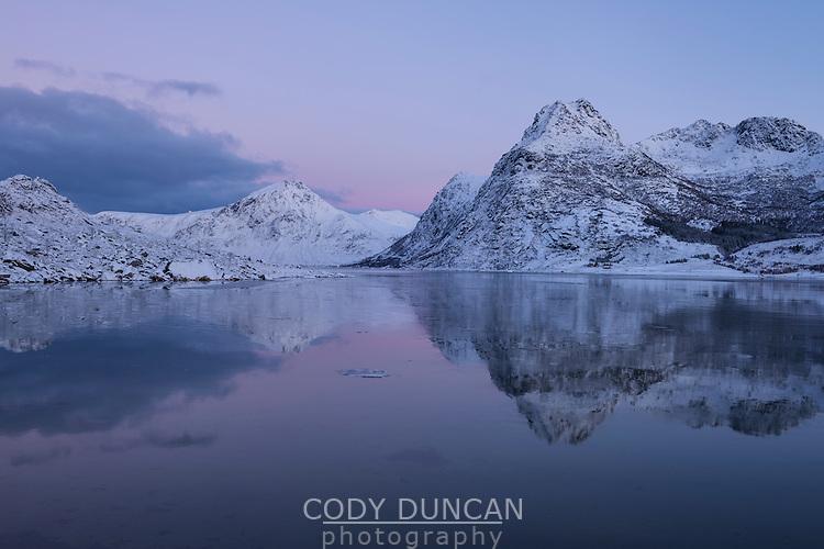 Soft twilight glow of December Mørketid - Polar Night in Flakstadpollen, Lofoten Islands, Norway