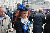 Woman with Iron Lady rosette.  Funeral of ex-Prime Minister Margaret Thatcher, City of London.