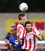 Lincoln City's Sean Raggett, centre, and Lincoln City's Michael Bostwick vie for possession with Chesterfield's Chris O'Grady <br /> <br /> Photographer Chris Vaughan/CameraSport<br /> <br /> The EFL Sky Bet League Two - Lincoln City v Chesterfield - Saturday 7th October 2017 - Sincil Bank - Lincoln<br /> <br /> World Copyright &copy; 2017 CameraSport. All rights reserved. 43 Linden Ave. Countesthorpe. Leicester. England. LE8 5PG - Tel: +44 (0) 116 277 4147 - admin@camerasport.com - www.camerasport.com
