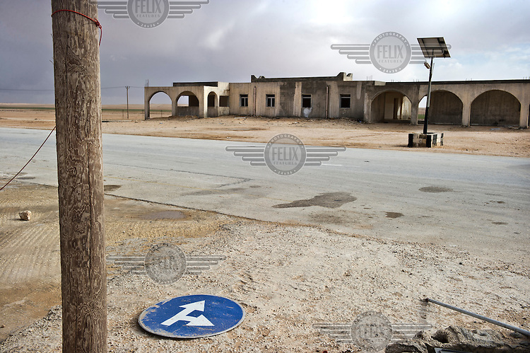 A burned and abandoned police post near Tobruk.  On 17 February 2011 Libya saw the beginnings of a revolution against the 41 year regime of Col Muammar Gaddafi.