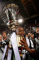 Calcio, finale Tim Cup: Juventus vs Lazio. Roma, stadio Olimpico, 20 maggio 2015.<br /> Juventus' Patrice Evra holds the trophy at the end of the Italian Cup final football match between Juventus and Lazio at Rome's Olympic stadium, 20 May 2015. Juventus won 2-1 after extra time.<br /> UPDATE IMAGES PRESS/Isabella Bonotto