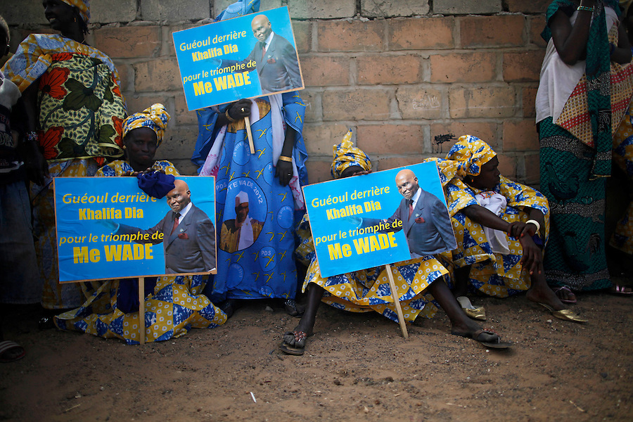 President Abdoualaye Wade campaigns in Gueoul, Louga Region. Women wait in the street while he speaks inside a small stadium. February 9, 2012. Gabriela Barnuevo