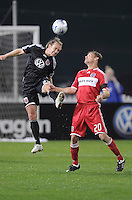 DC United defender Bryan Namoff (26) heads the ball against Chicago Fire forward Brian McBride (20) Chicago Fire tied DC United 1-1at  RFK Stadium, Saturday March 28, 2009.