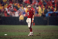SAN FRANCISCO, CA:  Quarterback Steve Young of the San Francisco 49ers stands in the rain during the NFC Divisional Playoff game against the Minnesota Vikings at Candlestick Park in San Francisco, California on January 3, 1998. (Photo by Brad Mangin)