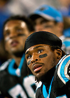 Carolina Panthers running back DeAngelo Williams (34) watches the scoreboard against the Arizona Cardinals during the NFC Divisional Playoff football game at Bank of America Stadium, in Charlotte, NC. Arizona defeated the Carolina Panthers 33-13.