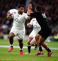 Photo: Richard Lane/Richard Lane Photography. England v New Zealand. QBE Autumn International. 08/11/2014. Ebgland's Billy Vunipola is tackled by New Zealand's  Charlie Faumuina.