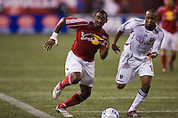 Red Bulls defender (2) Marvell Wynne and Real Salt Lake defender (16) Willis Forko race for the ball. The New York Red Bulls defeated Real Salt Lake 6-0 in an MLS regular season match at Giants Stadium, East Rutherford, NJ, August 26, 2006.