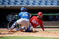 Philadelphia Phillies shortstop Luis Garcia (5) slides home as catcher Hagen Danner (26) applies the tag during a Florida Instructional League game against the Toronto Blue Jays on September 24, 2018 at Spectrum Field in Clearwater, Florida.  (Mike Janes/Four Seam Images)