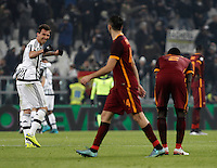Juventus' Mario Mandzukic, left, celebrates as Roma's players react at the end of the Italian Serie A football match between Juventus and Roma at Juventus Stadium. Juventus won 1-0.