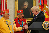 United States President Donald J. Trump greets members of the Native American code talkers during an event in the Oval Office of the White House, on October 27, 2017 in Washington, DC.<br /> Credit: Oliver Contreras / Pool via CNP