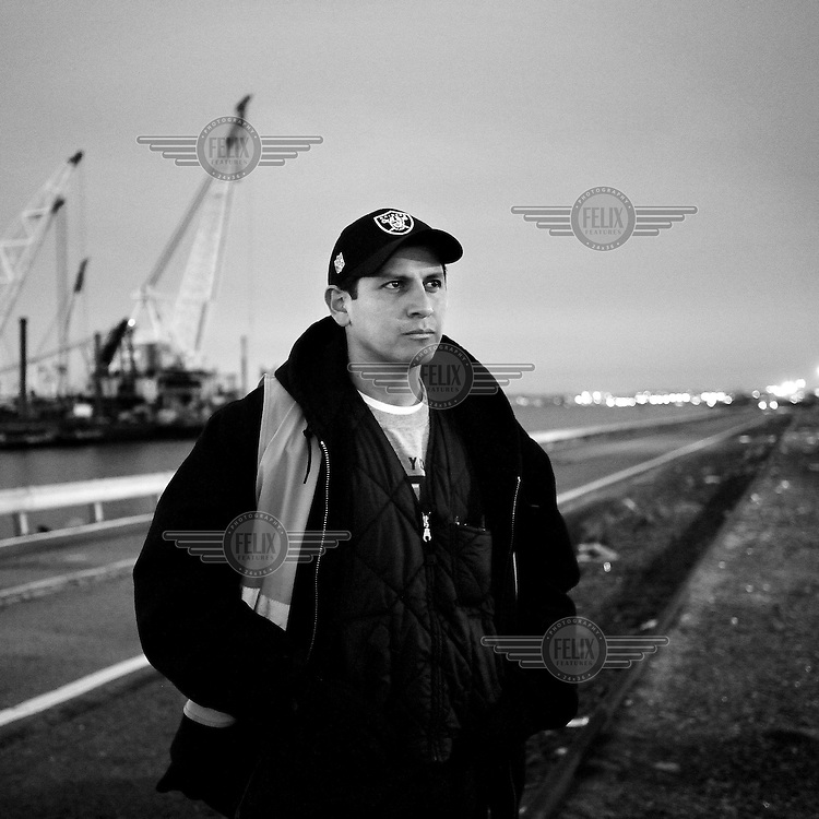 Longshoreman Jorge Aguilar photographed outside Global Docks, Bayonne, New Jersey. The docks of New York and New Jersey have for generations been synonymous with organised crime, with the Genovese family in control of the New Jersey waterfront and the Gambinos in control of the New York side.
