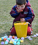 Eli Blumenthal, 5, of South Windsor, enjoys one of the candies he collected from his plastic eggs he collected, during the 41st Annual Imperial Oil Egg Hunt,  Friday, April 6, 2012, at South Windsor High School. (Jim Michaud/Journal Inquirer).