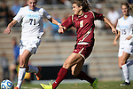 03 November 2013: Boston College's Stephanie McCaffrey (9) shoots past North Carolina's Hanna Gardner (71). The University of North Carolina Tar Heels hosted the Boston College Eagles at Fetzer Field in Chapel Hill, NC in a 2013 NCAA Division I Women's Soccer match and the quarterfinals of the Atlantic Coast Conference tournament. North Carolina won the game 1-0.
