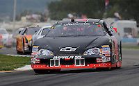 Aug. 8, 2009; Watkins Glen, NY, USA; NASCAR Nationwide Series driver J.R. Fitzpatrick (4) during the Zippo 200 at Watkins Glen International. Mandatory Credit: Mark J. Rebilas-