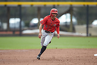 Matt Rudick (9) of the San Diego State Aztecs hustles towards third base against the UNCG Spartans at Springs Brooks Stadium on February 16, 2020 in Conway, South Carolina. The Spartans defeated the Aztecs 11-4.  (Brian Westerholt/Four Seam Images)