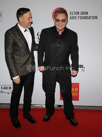 New York,NY- October 28: David Furnish, Elton John attends the Elton John AIDS Foundation's 13th Annual An Enduring Vision Benefit at Cipriani Wall Street on October 28, 2014 in New York City In New York City on October 27, 2014 . Credit: John Palmer/MediaPunch