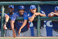 "Texas Rangers pitchers Neftali Feliz #30 and Yu Darvish #11 watch the MLB exhibition baseball game against the ""AAA"" Round Rock Express on April 2, 2012 at the Dell Diamond in Round Rock, Texas. The Rangers out-slugged the Express 10-8. (Andrew Woolley / Four Seam Images)."