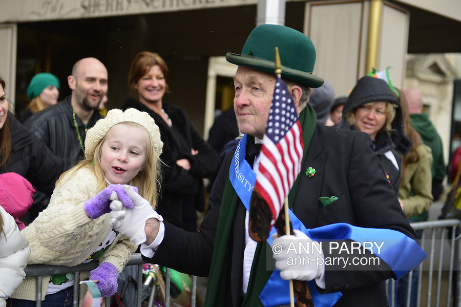 March 16, 2013 - New York, NY, U.S. - 'Leprechaun' NOEL RYAN, an alumnus of Quinnipiac College, greets those in crowd at the 252nd annual NYC St. Patrick's Day Parade. Thousands of marchers show their Irish pride, as they march up Fifth Avenue, and over a million people, often in green and orange, watch and celebrate.