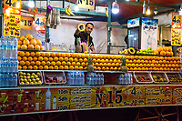 Marrakesh, Morocco.  Vendor of Fruit Juice and Bottled Water, Place Jemaa El-Fna.