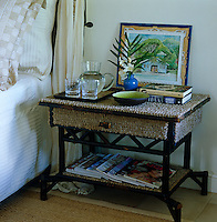 One of a pair of bedside tables in a guest bedroom that has been designed with a rope-effect surface