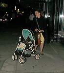 10-1-09.Exclusive.. .Julie Delpy listening to her ipod while walking down sunset blvd at 11pm at night with her baby. Julie was leaving a store called the Pink Dot in Hollywood California....AbilityFilms@yahoo.com.805-427-3519.www.AbilityFilms.com