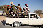 OTJIWARONGO, NAMBIA- AUGUST 12: Herero men parading in traditional military uniforms during a march when commemorating fallen chiefs killed in battles with Germans. The area was the venue for decisive battles of the Herero uprisings in 1904.  The Herero accuse the German Empire of Genocide of its people from 1904-07. They are currently trying to make the German government compensate the descendants of the people killed. (Photo by Per-Anders Pettersson)