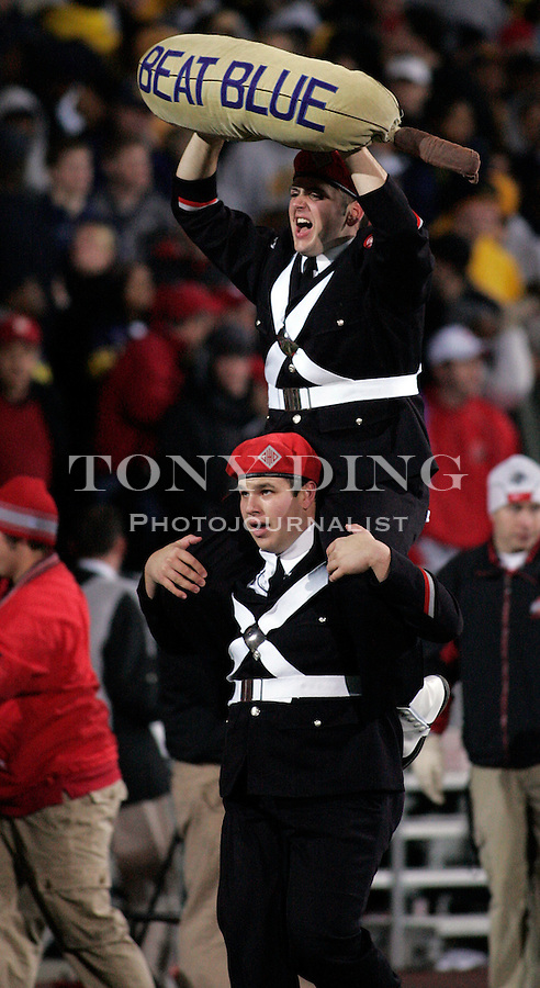 "18 Nov 2006: Ohio State band members run a sack labled ""BEAT BLUE"" piggy-back across the field in celebration of an OSU touchdown, during Ohio State's 42-39 win over Michigan in a college football game at Ohio Stadium in Columbus, OH."