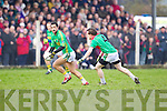 Paul Galvin of Finuge breaks away from Beal's Colm Kissane in the Bernard O'Callaghan Memorial Senior Football Championship Final last Sunday in Ballylongford.
