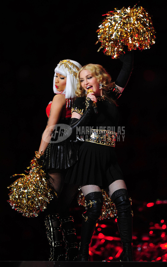 Feb 5, 2012; Indianapolis, IN, USA; Recording artists Nicki Minaj (left) and Madonna (right) perform during the halftime show for Super Bowl XLVI between the New York Giants and New England Patriots at Lucas Oil Stadium.  Mandatory Credit: Mark J. Rebilas-