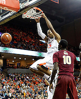 Virginia forward Akil Mitchell (25) dunks the ball next to Florida State forward Okaro White (10) and Florida State forward Jarquez Smith (5) during the second half of an NCAA basketball game Saturday Jan. 18, 2014 in Charlottesville, VA. Virginia defeated Florida State 78-66. (AP Photo/Andrew Shurtleff)