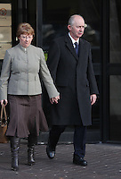 Pictured: Malcolm Fyfield (R) with his wife leaving Swansea Crown Court. Thursday 27 March 2014<br /> Re: The trial of a mine manager over the deaths of four miners at a Swansea Valley pit has started.<br /> Malcolm Fyfield, 58, was manager of the Gleision drift mine near Cilybebyll when it flooded in September 2011.<br /> David Powell, 50, Charles Breslin, 62, Phillip Hill, 44, and Garry Jenkins, 39, died in the incident.<br /> Mr Fyfield denies manslaughter while MNS Mining, the company which operated the site, denies corporate manslaughter.<br /> The prosecution opened its case at Swansea Crown Court on Thursday.<br /> The defence told the trial that it was agreed that Mr Fyfield suffered from post traumatic stress disorder and that would affect how he was able to deal with evidence. He will require breaks and may need to leave the court on occasions.
